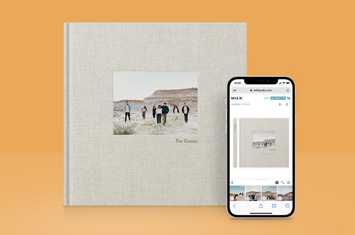 A Premium Photo Book next to a smartphone device