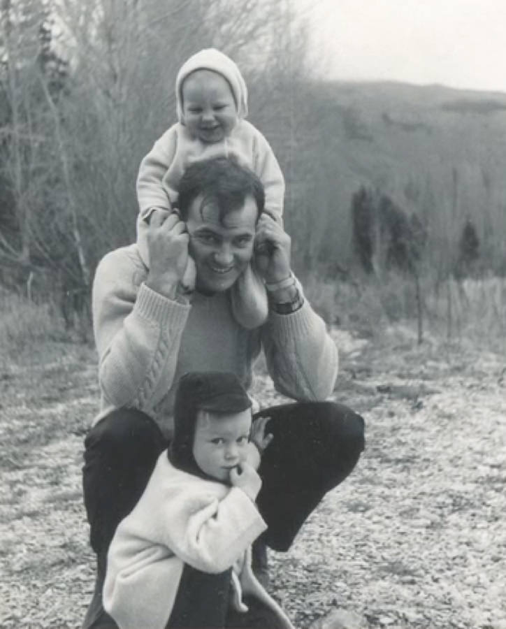 Geoff on his Dad's shoulders with his brother Paul.