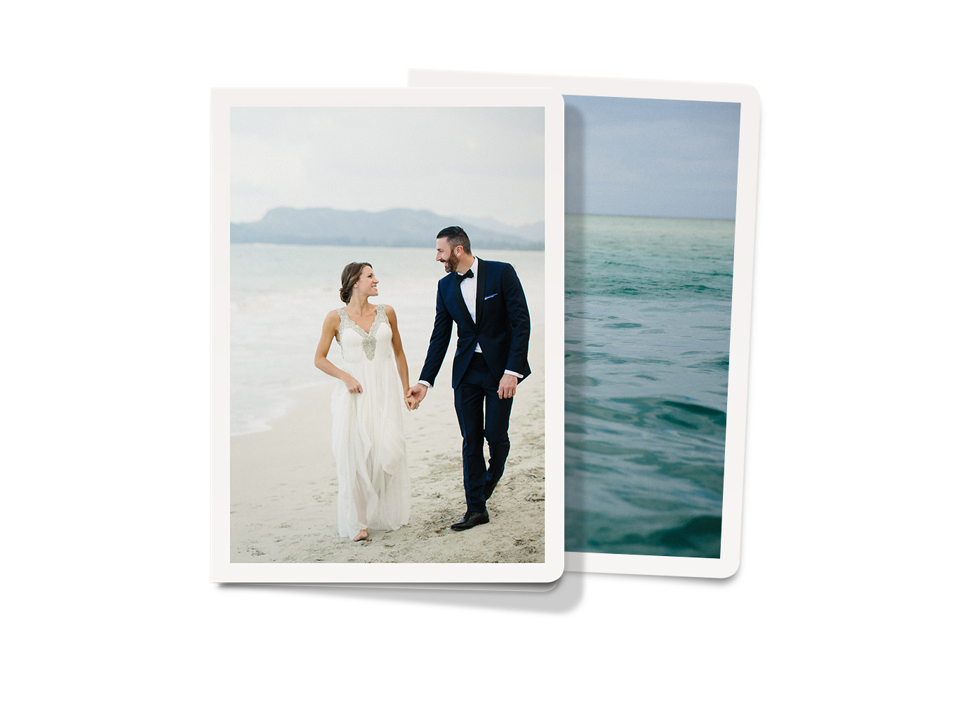 Two portrait greeting cards. One with a newlywed couple on the beach and one with a scenic ocean photograph.