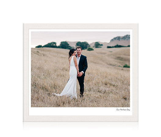 Classic landscape photo album with wedding image on the cover