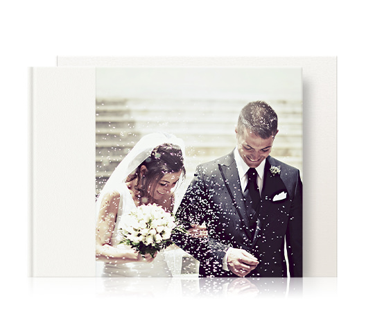 Leather landscape wedding photo album with a 3/4 image cover of a couple covered in confetti.