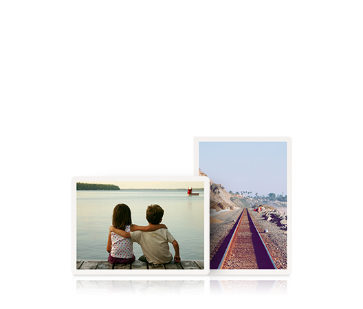 Two greeting cards. One landscape card with two children with their arms around each other and one portrait card of a railway track.