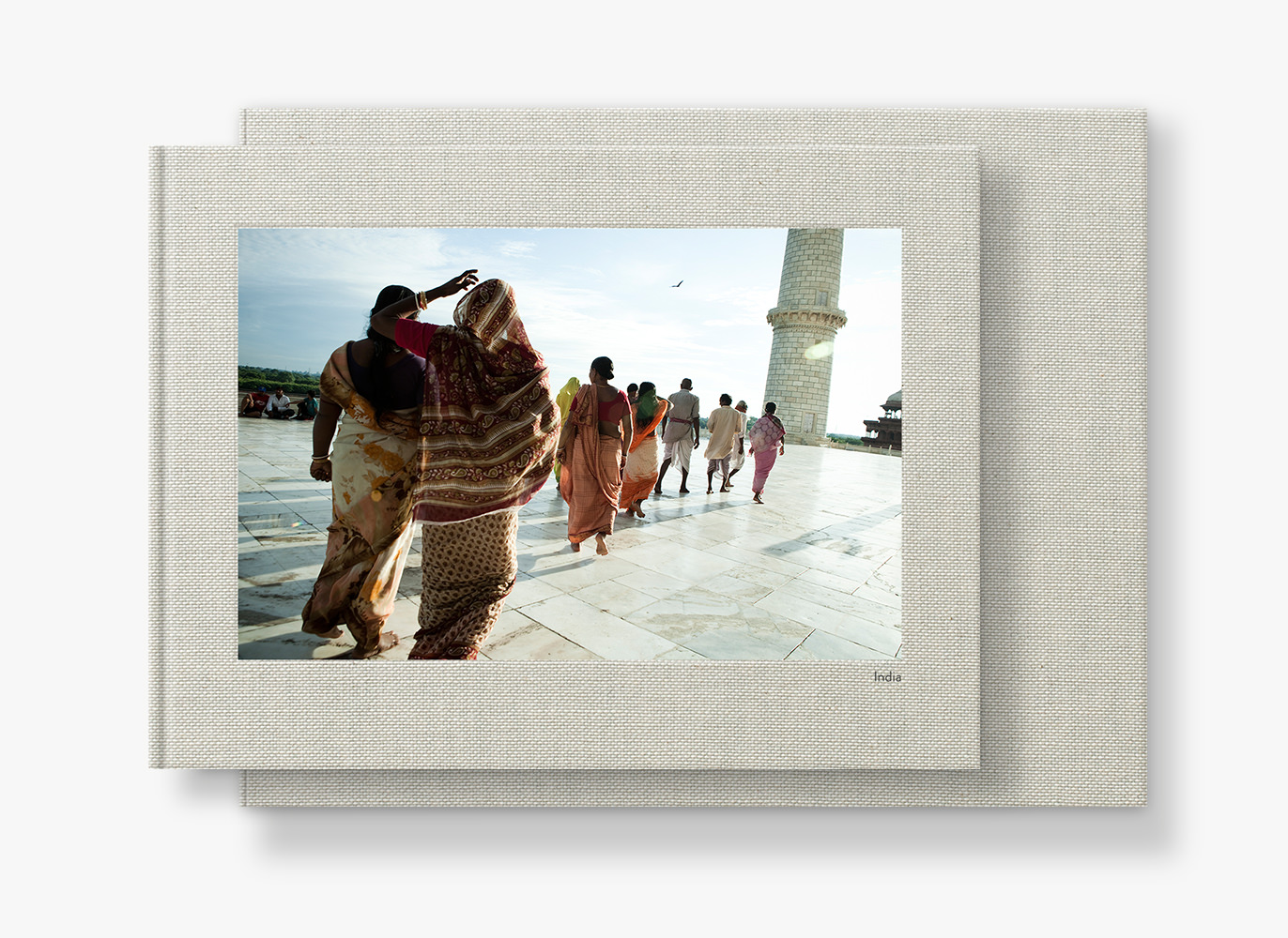 Presentation box and landscape photo book with cover image of people in India