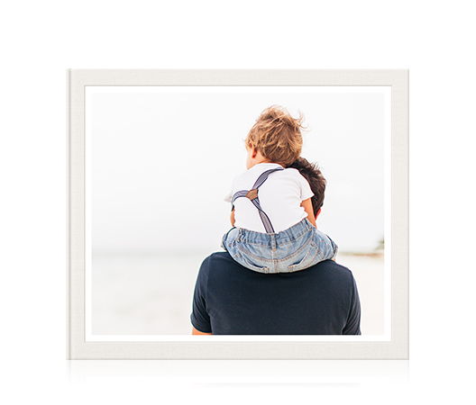 Large classic photo book with cover image of a young boy sitting on his father's shoulders