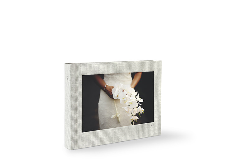 ClassicPremium Photo book with a bride holding a bouquet on the cover.