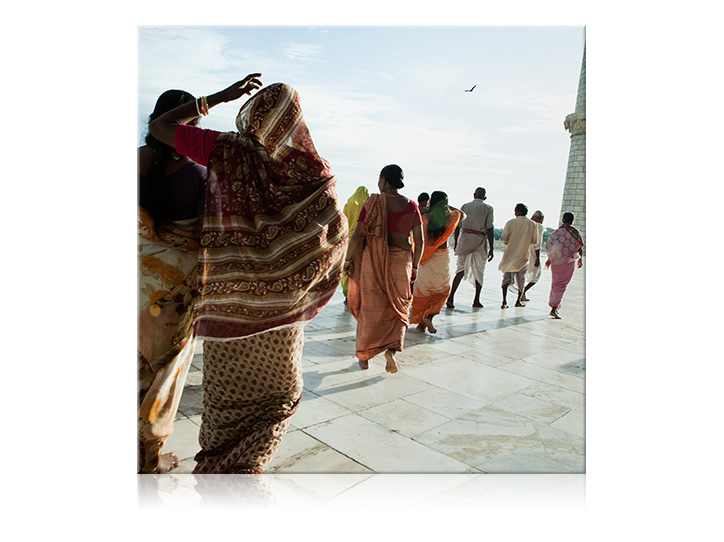 Square canvas print of people walking in their colorful traditional dress.