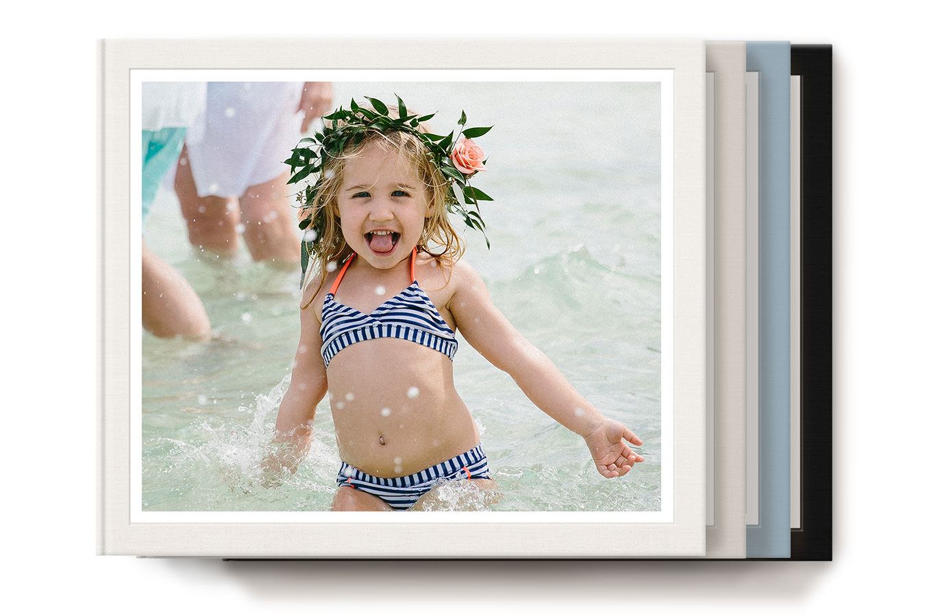 Stack of four classic photo books with cover image of a child in the ocean.