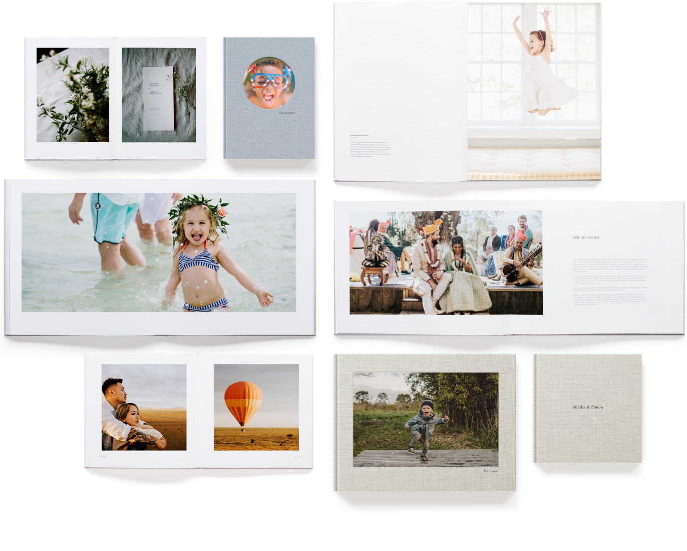 Selection of premium photo books showing designer layouts.