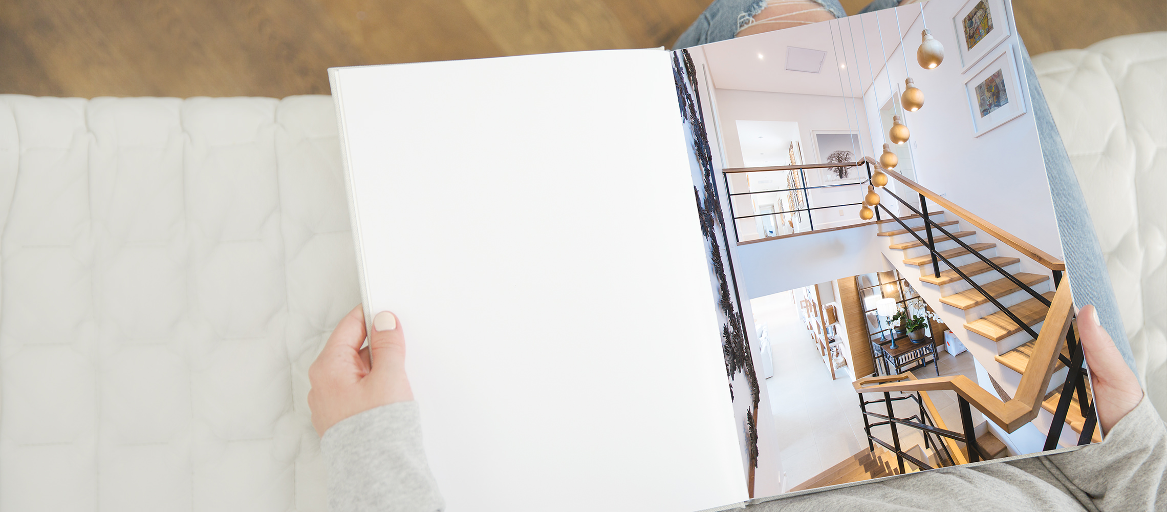 Woman looking through her premium portrait photo book of her home interior.