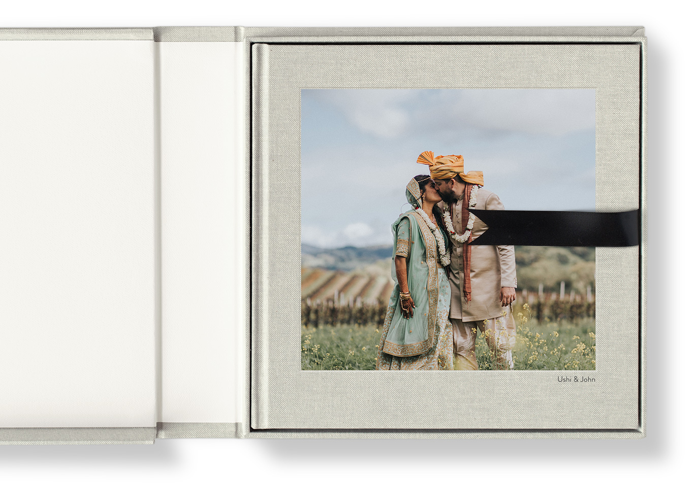 Premium square photo album and matching presentation box with a fine silk lift-out ribbon.