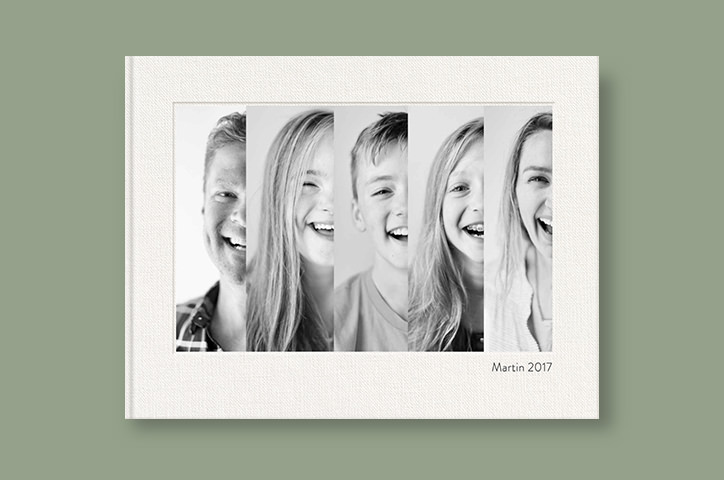 Photo book showing family of five on cover
