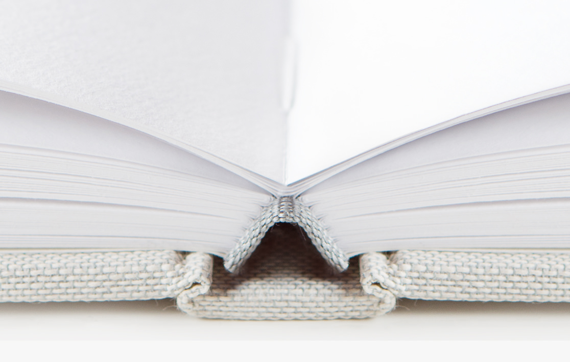 Closeup of premium photo book section-sewn binding.