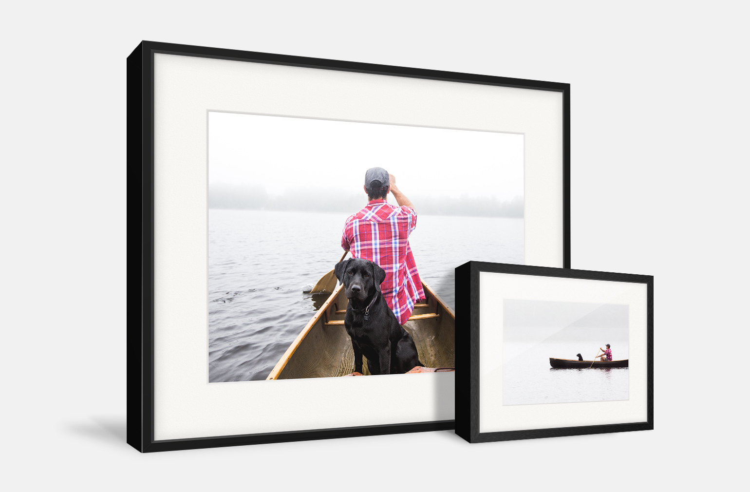 Two gallery frames side by side of a man and his dog on a canoe.