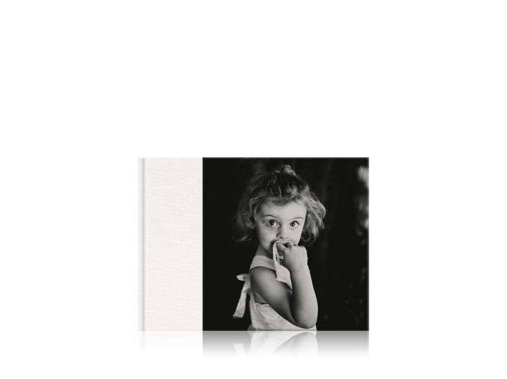 Landscape premium baby photo book with 3/4 cover of a young girl.