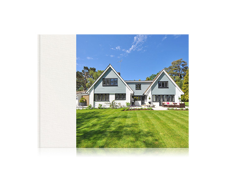Landscape premium home photo book with a 3/4 cover of a house.