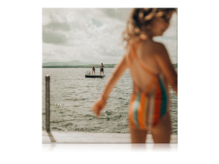 Canvas print of young girl by the ocean