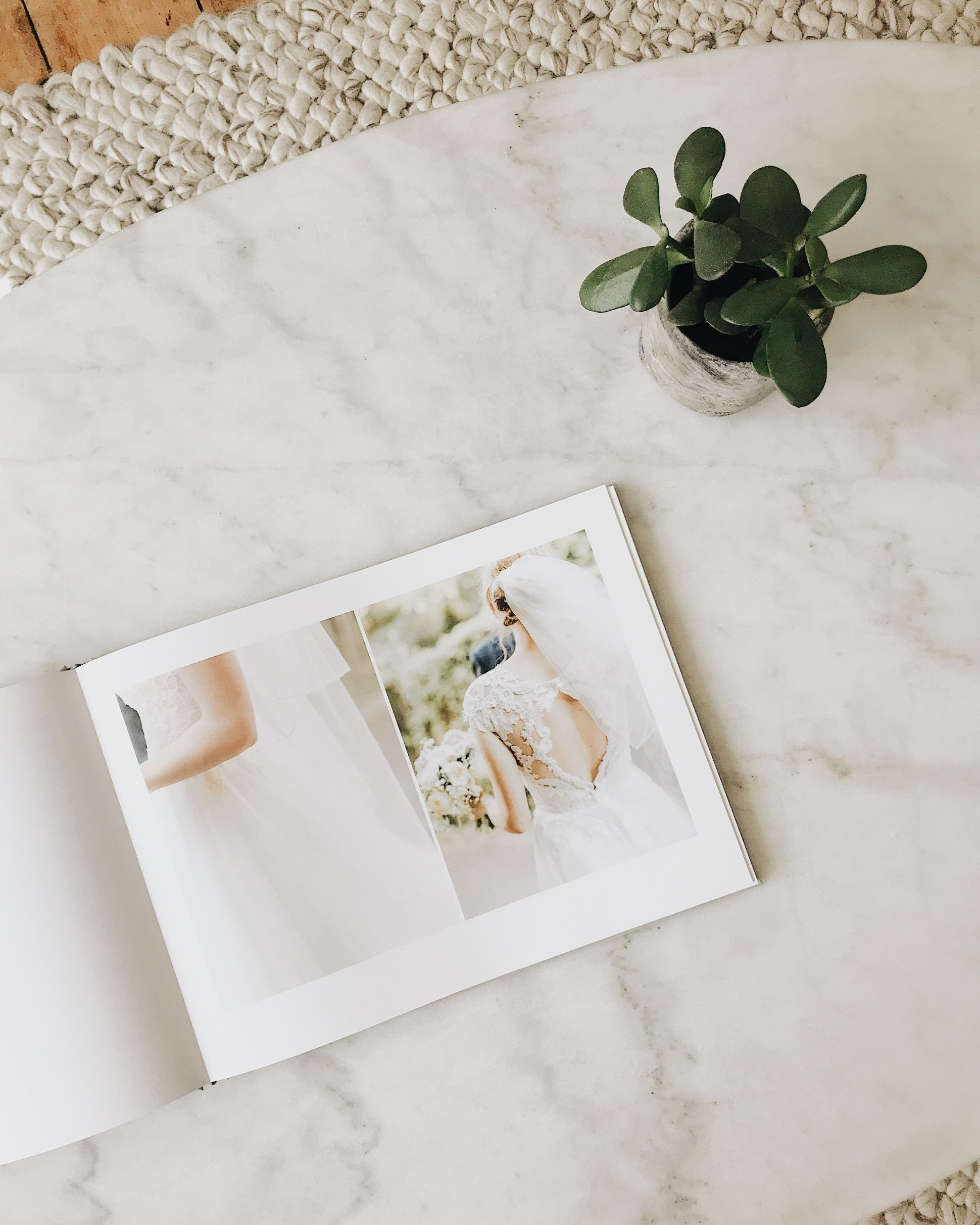 Opening wedding book showing photos of bride