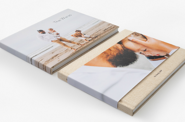 Two landscape premium photo books one with full jacket and one with partial jacket