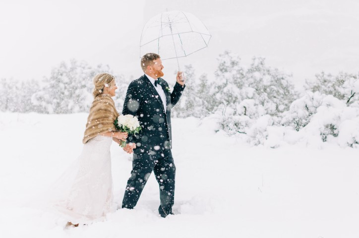Newlyweds in the snow.