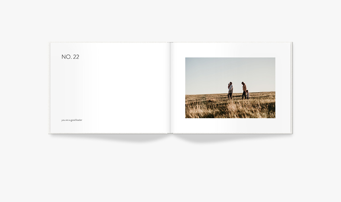 Open Photo Book showing image of family in the grass