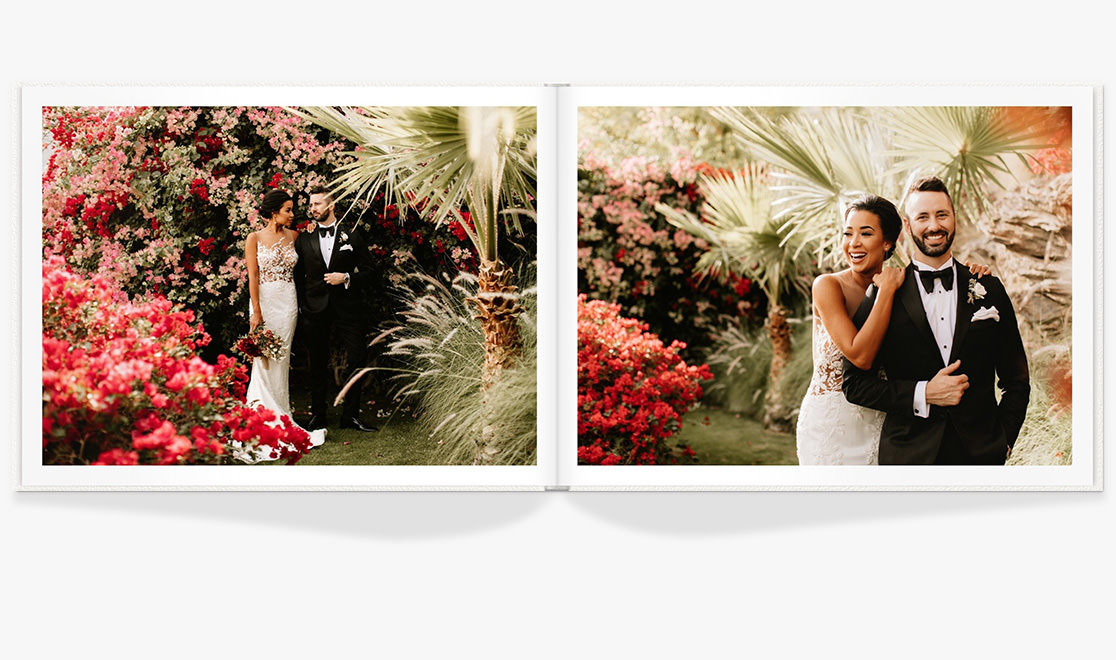 Open Wedding Photo Album showing spread of newlywed portraits