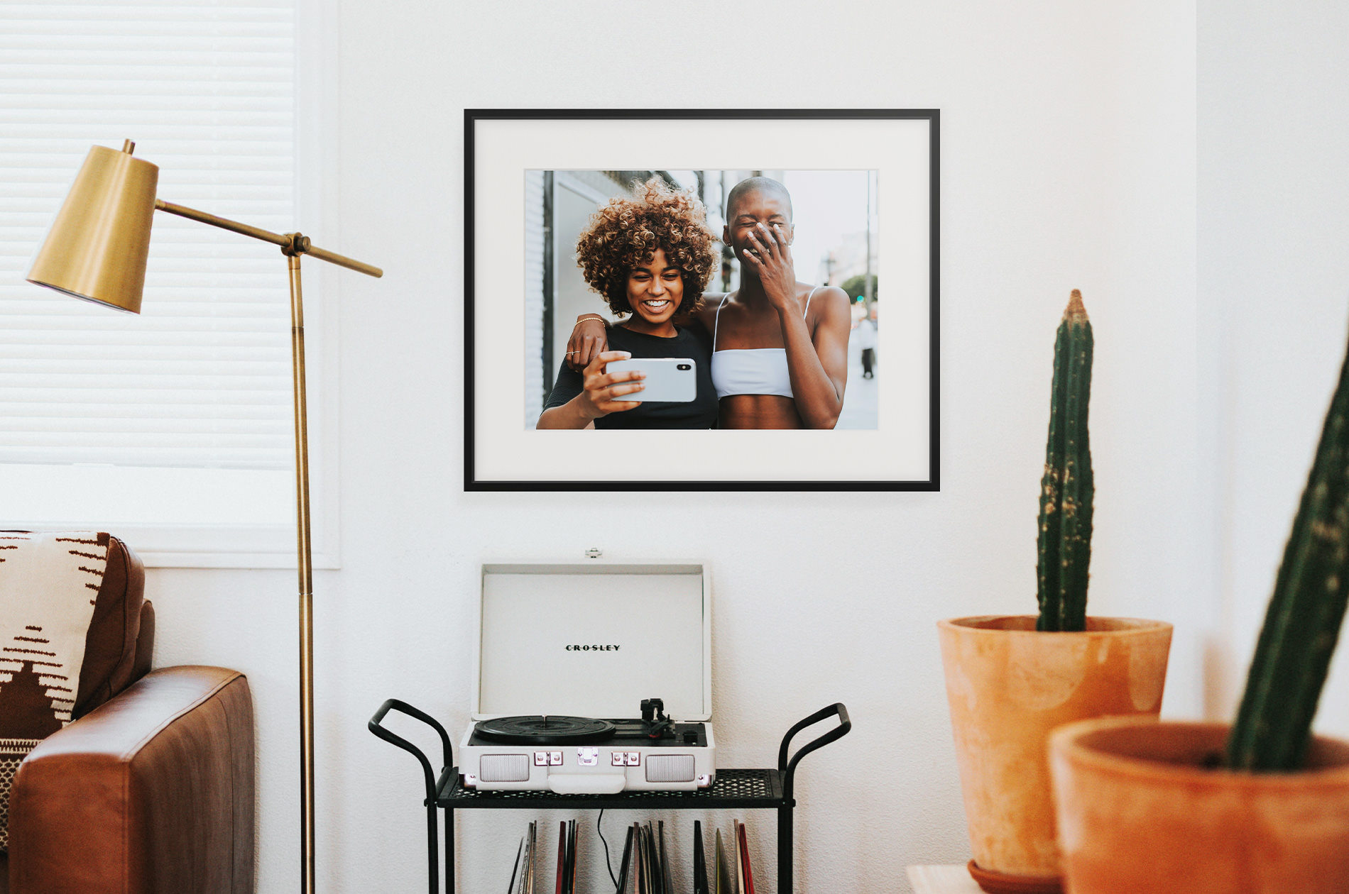 Black Metal Gallery Frame displayed in home showing photo of two friends laughing
